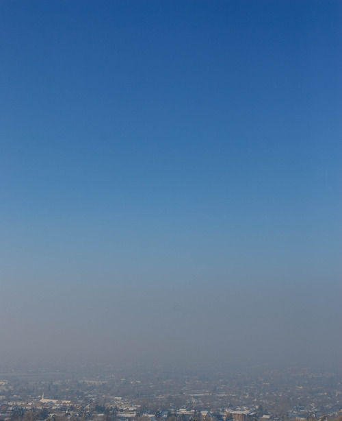 Trent Nelson  |  The Salt Lake Tribune Smog trapped in an inversion layer over Salt Lake City, Tuesday, January 22, 2013.