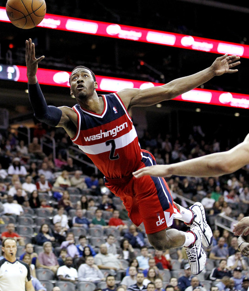 Washington Wizards' John Wall shoots in the third quarter of an NBA basketball game against the New Jersey Nets, Wednesday, March 21, 2012, in Newark, N.J. The Wizards won 108-89. (AP Photo/Julio Cortez)