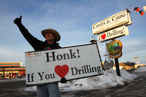"Francisco Kjolseth  |  The Salt Lake Tribune George Burnett, owner of Covers & Camo in Vernal, where he sells custom seat covers along with apparel and stickers with the slogan ""I (Heart) Drilling!"", has recently started a new venture and a new controversy. Added to his shop is the I Love Drilling Juice & Smoothie Bar where liberals pay more. As Burnett puts it ""liberal policies are costing us more,"" and thus if you admit to being liberal you can expect to pay a dollar more for your drink."