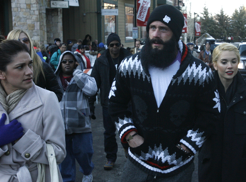 "Rick Egan  | The Salt Lake Tribune   San Francisco Giants pitcher ""fear the beard"" Brian Wilson walks down on lower Main Street in Park City, Saturday, Jan. 19, 2013."