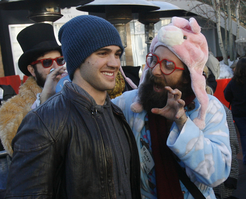 Rick Egan  | The Salt Lake Tribune   Steven R. McQueen (blue cap) poses for photos with fans on Main Street in Park City, Saturday, Jan. 19, 2013.