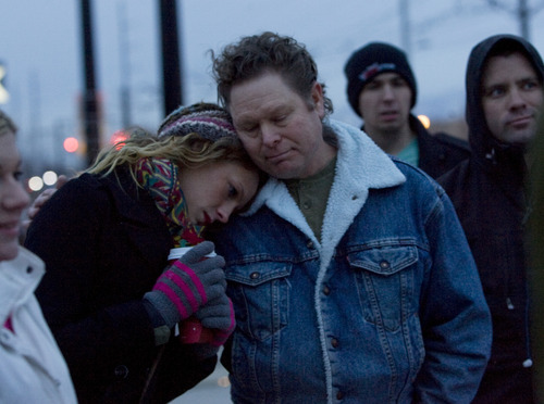 Kim Raff  |  The Salt Lake Tribune Kayleen Willard is comforted by her father, Fred Willard, as three dozen people gather outside the West Valley City Hall Sunday for a vigil for Danielle Willard, who was shot by West Valley Police on Nov. 2 as she sat in her car unarmed.