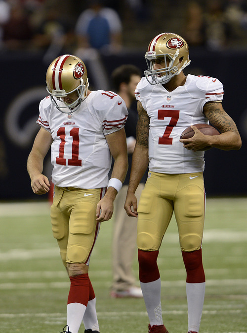 San Francisco 49ers quarterback Alex Smith (11) and quarterback Colin Kaepernick (7) warm up before an NFL football game against the New Orleans Saints at the Louisiana Superdome in New Orleans, Sunday, Nov. 25, 2012. (AP Photo/Gerald Herbert)
