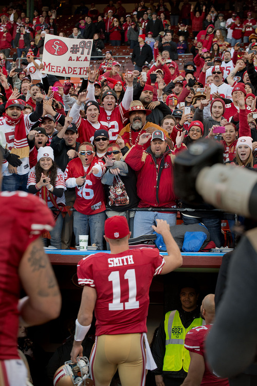 Fans cheer as 49ers' quarterback Alex Smith (11) leaves the field after an NFL football game against  the Arizona Cardinals at Candlestick Park in San Francisco on Sunday, Dec.  30, 2012. (AP Photo/The Sacramento Bee, Randall Benton) MANDATORY CREDIT