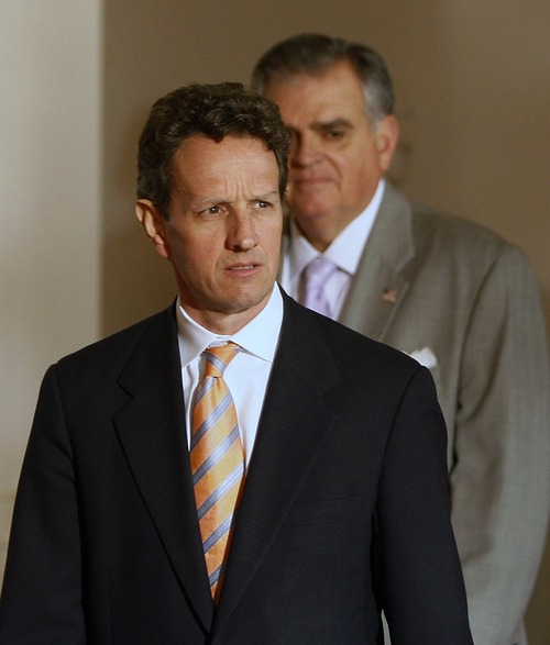 FILE - In this Monday, March 30, 2009, file photo, Treasury Secretary Timothy Geithner, left, followed by Transportation Secretary Ray LaHood, arrive in the Grand Foyer of the White House in Washington. The auto support effort was actually begun under the Bush administration but taken over and expanded by Obama and Geithner. Administration officials have said the effort saved more than a million jobs and came at a critical time when the economy was in severe crisis. (AP Photo/Ron Edmonds)