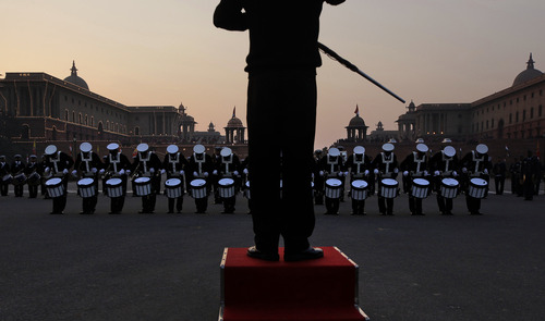 Members of India's military band rehearse for Beating Retreat ceremony at Raisina hill which houses India's most important ministries and the presidential palace in New Delhi, India,Thursday, Jan. 24, 2013. The ceremony is held annually on Jan. 29,  marking the end of republic day celebrations. (AP Photo /Manish Swarup)