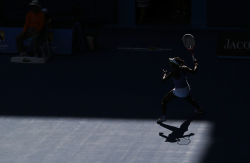 Sloane Stephens of the US hits a return during her semifinal match against Victoria Azarenka of Belarus at the Australian Open tennis championship in Melbourne, Australia, Thursday, Jan. 24, 2013. (AP Photo/Andy Wong)