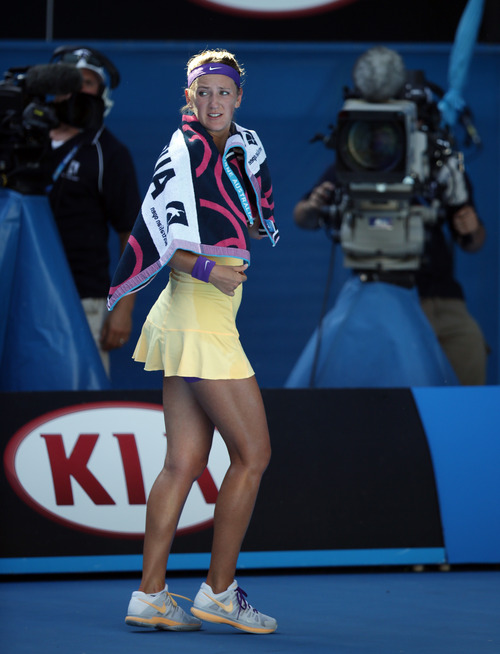 Victoria Azarenka of Belarus walks off the court to take a medical time out during her semifinal match against Sloane Stephens of the US at the Australian Open tennis championship in Melbourne, Australia, Thursday, Jan. 24, 2013. (AP Photo/Dita Alangkara)