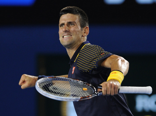 Serbia's Novak Djokovic celebrates after defeating Spain's David Ferrer in their semifinal match at the Australian Open tennis championship in Melbourne, Australia, Thursday, Jan. 24, 2013. (AP Photo/Andrew Brownbill)