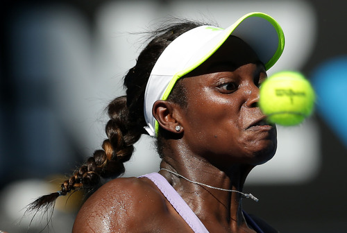 Sloane Stephens of the US hits a forehand return  to Victoria Azarenka of Belarus during their semifinal match at the Australian Open tennis championship in Melbourne, Australia, Thursday, Jan. 24, 2013. (AP Photo/Aaron Favila)