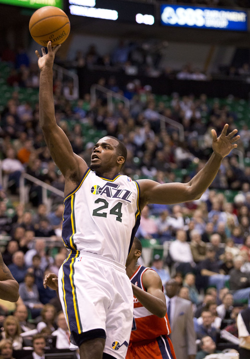 Lennie Mahler  |  The Salt Lake Tribune Jazz forward Paul Millsap puts up a floater first half of a basketball game against the Washington Wizards at EnergySolutions Arena in Salt Lake City, Utah. Wednesday, Jan. 23, 2013.