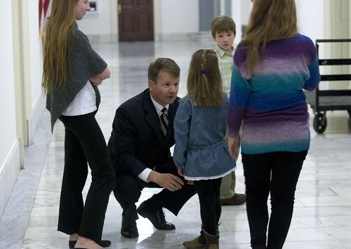 Scott Sommerdorf      The Salt Lake Tribune Congressman Chris Stewart's brother Tim Stewart speaks to his children in the hallway just outside his brother's office in Washington D.C., Thursday, Jan. 3, 2013.