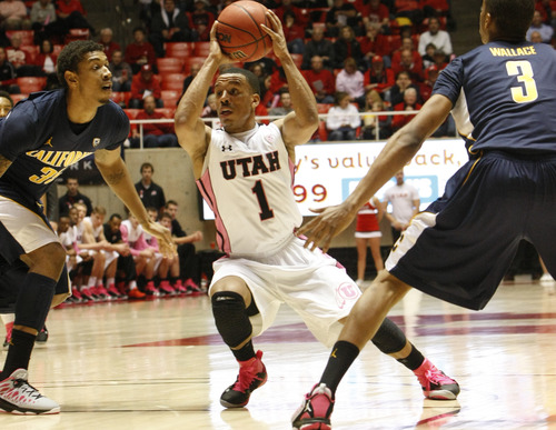 Chris Detrick  |  The Salt Lake Tribune Utah Utes guard Glen Dean (1) is guarded by California Golden Bears guard Justin Cobbs (1) and California Golden Bears guard Tyrone Wallace (3) during the first half of the game at the Huntsman Center Thursday January 24, 2013. Cal is winning the game 32-22.