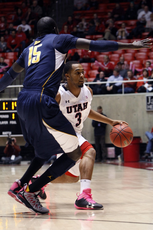Chris Detrick  |  The Salt Lake Tribune Utah Utes guard Justin Seymour (3) is guarded by California Golden Bears forward Bak Bak (15) during the first half of the game at the Huntsman Center Thursday January 24, 2013. Cal is winning the game 32-22.