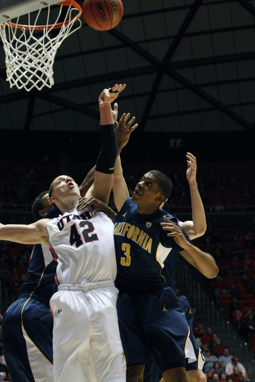 Chris Detrick  |  The Salt Lake Tribune Utah Utes center Jason Washburn (42) and California Golden Bears guard Tyrone Wallace (3) go up for a rebound during the first half of the game at the Huntsman Center Thursday January 24, 2013. Cal is winning the game 32-22.