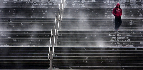 Steve Griffin | The Salt Lake Tribune   Steam rises from heated stairs outside the Huntsman Center on the campus of the University of Utah Thursday January 24, 2013 in Salt Lake City, Utah. Students struggled to get to class as a layer of freezing rain covered the sidewalks