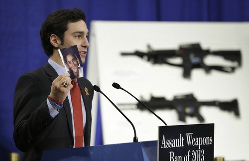 Omar Samaha, holds a picture of his sister Reema Samaha, who was killed in the Virginia Tech. shootings, Thursday, Jan. 24, 2013, during a news conference on Capitol Hill in Washington to introduce legislation on assault weapons and high-capacity ammunition feeding devices.  Congressional Democrats are reintroducing legislation to ban assault weapons but the measure faces long odds even after last month's mass school shooting in Newtown, Conn. The measure being unveiled Thursday is authored by Democratic Sen. Dianne Feinstein of California, who wrote the original assault weapons ban. That law expired in 2004 when Congress refused to renew it under pressure from the National Rifle Association.  (AP Photo/Manuel Balce Ceneta)