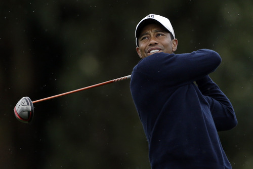 Tiger Woods watches his tee shot on the 15th hole of the north course at the Torrey Pines during the second round of the Farmers Insurance Open golf tournament, Friday, Jan. 25, 2013, in San Diego. (AP Photo/Gregory Bull)