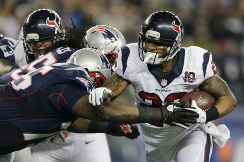 New England Patriots defensive tackle Vince Wilfork, left, tries to tackle Houston Texans running back Arian Foster during the first half of an AFC divisional playoff NFL football game in Foxborough, Mass., Sunday, Jan. 13, 2013. (AP Photo/Charles Krupa)