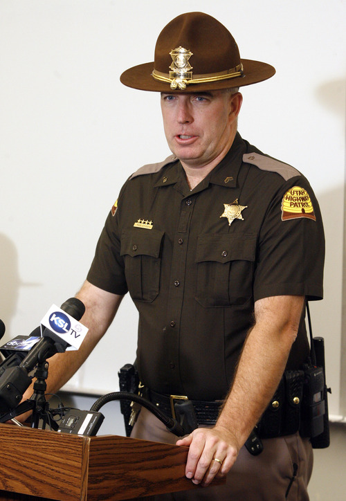 Rick Egan  |  The Salt Lake Tribune  Utah Highway Patrol Trooper Todd Johnson encourages motorists to slow down during winter driving conditions at a news conference Friday, January 25, 2013. Four troopers were hit while assisting motorists during the ice storm Thursday.
