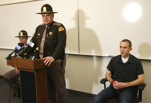Rick Egan  |  The Salt Lake Tribune  Utah Highway Patrol Trooper David Brooks, left, and Trooper Kris Cope, right, listen as Steven Winward talks Friday at a news conference about the dangerous conditions on the roads Thursday. Brooks and Cope were two of four troopers who were hit while assisting motorists during Thursday's ice storm.