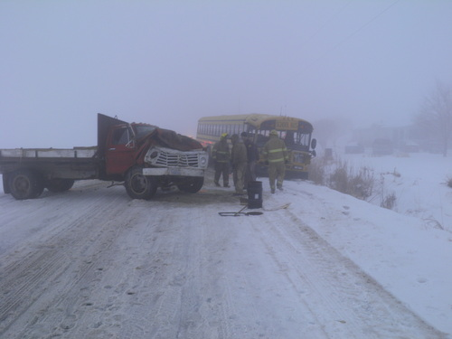 Courtesy | Box Elder County Sheriff's Office A school bus and a farm truck collided Friday morning while traveling on a foggy, snow-covered road near Corinne. The bus was carrying 30 students, and three were taken to the hospital with minor injuries.