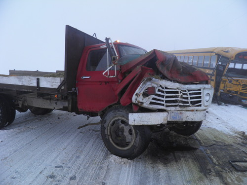 Courtesy Box Elder County Sheriff's Office A school bus and a farm truck collided Friday morning while traveling on a foggy, snow-covered road near Corinne. The bus was carrying 30 students, and three were taken to the hospital with minor injuries.