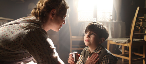 """Young Simon (Jonaton S. Wächter) learns lessons from his mother (Helen Sjöholm) in the Swedish drama """"Simon and the Oaks."""" Courtesy The Film Arcade"""
