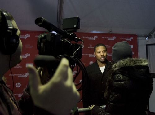 """Kim Raff     The Salt Lake Tribune Actor Michael B. Jordan -- who plays Oscar Grant in """"Fruitvale"""" -- gives an interview on the red carpet at the Sundance premiere on Jan. 19, 2013."""