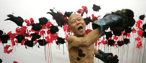 """Rick Egan    The Salt Lake Tribune   81-year-old old Japanese artist, Ushio Shinohara with his art, at the Central Utah Art Center, Monday, January 21, 2013. Shinohara is known for boxing his art onto a canvas, he is featured in the Sundance documentary film """"Cutie and the Boxer."""""""