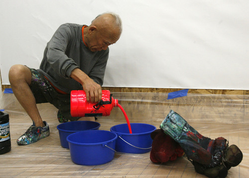 """Rick Egan    The Salt Lake Tribune   81-year-old old Japanese artist, Ushio Shinohara, pours paint before dipping his  boxing gloves, at the Central Utah Art Center, Monday, January 21, 2013. Shinohara, is featured in the Sundance documentary film """"Cutie and the Boxer."""""""