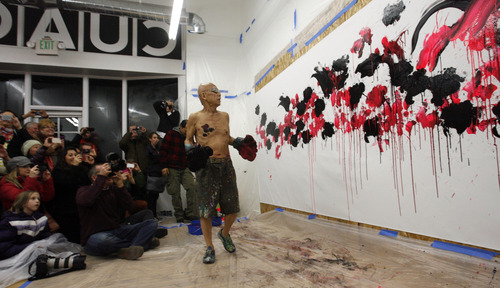 """Rick Egan    The Salt Lake Tribune   The crowd cheers as Japanese artist, Ushio Shinohara, checks out the piece of art he just finished, using boxing gloves dipped in paint, at the Central Utah Art Center, Monday, January 21, 2013. Shinohara, is featured in the Sundance documentary film """"Cutie and the Boxer."""""""