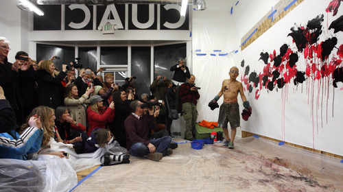 """Rick Egan    The Salt Lake Tribune   The crowd cheers as Japanese artist, Ushio Shinohara,  finishes his piece of art, at the Central Utah Art Center, Monday, January 21, 2013. Shinohara, is featured in the Sundance documentary film """"Cutie and the Boxer."""""""