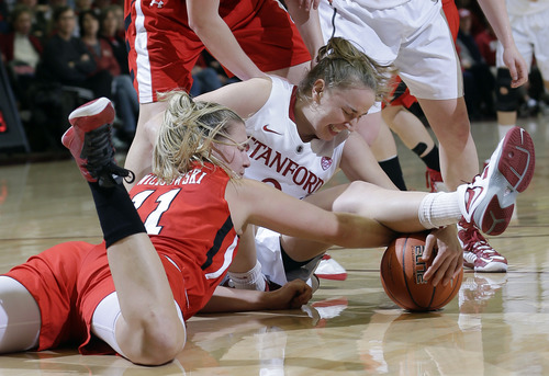 Stanford 's Mikaela Ruef (3), right, fights for a loose ball with Utah 's Taryn Wicijowski (11) during the first half of an NCAA college basketball game in Stanford, Calif., Friday, Jan. 25, 2013. (AP Photo/Marcio Jose Sanchez)