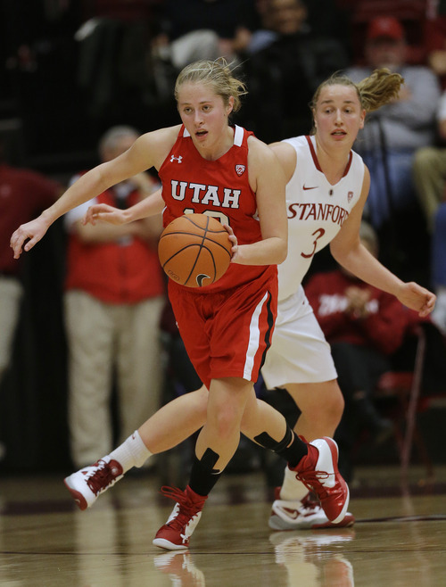Utah 's Rachel Messer (13) dribbles past Stanford 's Mikaela Ruef (3) during the second half of an NCAA college basketball game in Stanford, Calif., Friday, Jan. 25, 2013. (AP Photo/Marcio Jose Sanchez)