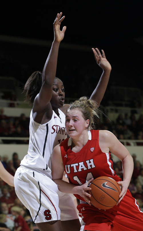 Utah 's Paige Crozon (14) is defended by Stanford 's Chiney Ogwumike during the second half of an NCAA college basketball game in Stanford, Calif., Friday, Jan. 25, 2013. (AP Photo/Marcio Jose Sanchez)