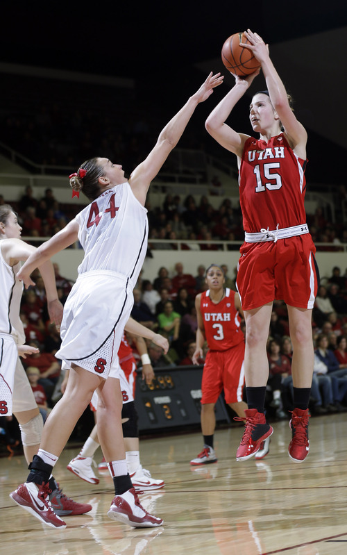Utah 's Michelle Plouffe (15) shoots over Stanford 's Joslyn Tinkle (44) during the second half of an NCAA college basketball game in Stanford, Calif., Friday, Jan. 25, 2013. (AP Photo/Marcio Jose Sanchez)