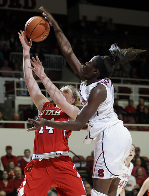 Stanford 's Chiney Ogwumike, right, blocks a shot attempt from Utah 's Paige Crozon during the second half of an NCAA college basketball game in Stanford, Calif., Friday, Jan. 25, 2013. (AP Photo/Marcio Jose Sanchez)