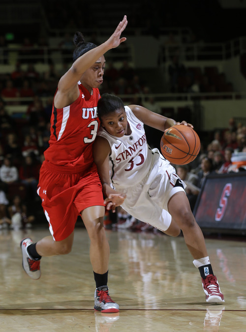 Stanford 's Amber Orrange (33) dribbles next to Utah 's Iwalani Rodrigues (3) during the first half of an NCAA college basketball game in Stanford, Calif., Friday, Jan. 25, 2013. (AP Photo/Marcio Jose Sanchez)