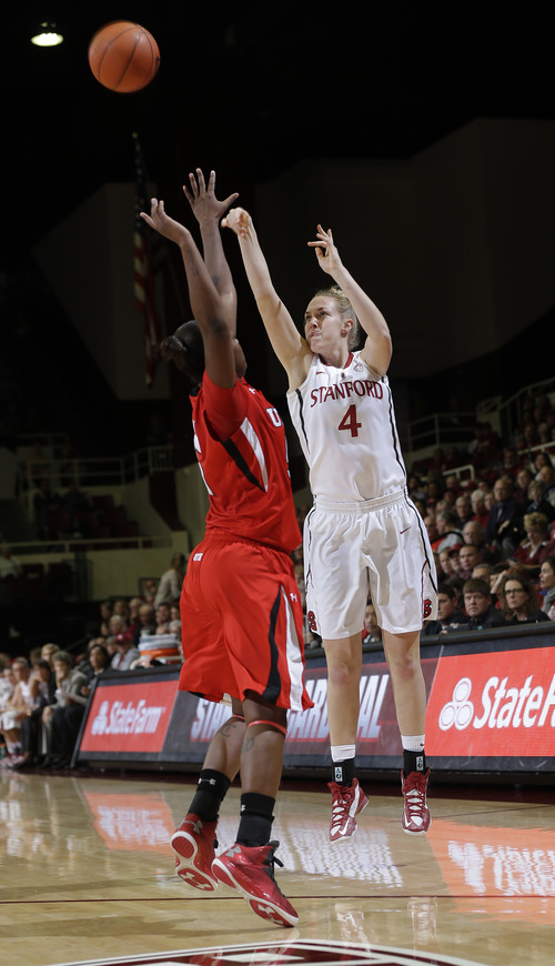 Stanford 's Taylor Greenfield (4) shoots over Utah 's Cheyenne Wilson (5) during the first half of an NCAA college basketball game in Stanford, Calif., Friday, Jan. 25, 2013. (AP Photo/Marcio Jose Sanchez)