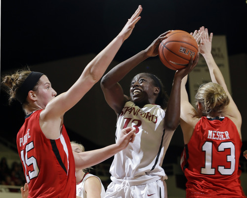 Stanford 's Chiney Ogwumike (13) shoots between Utah 's Michelle Plouffe (15) and Rachel Messer (13) during the first half of an NCAA college basketball game in Stanford, Calif., Friday, Jan. 25, 2013. (AP Photo/Marcio Jose Sanchez)