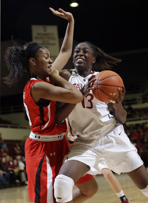 Stanford 's Chiney Ogwumike (13) is defended by Utah 's Ariel Reynolds, left, during the first half of an NCAA college basketball game in Stanford, Calif., Friday, Jan. 25, 2013. (AP Photo/Marcio Jose Sanchez)