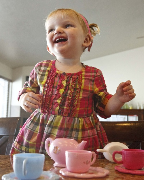 Leah Hogsten  |  The Salt Lake Tribune Daisy Doutre, 22 months, became deaf after contracting cytomegalovirus in utero. Daisy now wears cochlear implants.