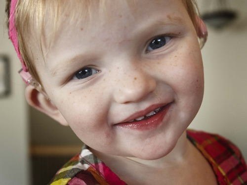 Leah Hogsten  |  The Salt Lake Tribune Daisy Doutre, 22 months, became deaf after contracting a virus called cytomegalovirus in utero. Daisy now wears cochlear implants.