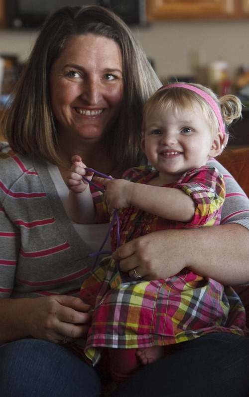 Leah Hogsten  |  The Salt Lake Tribune Sara Doutre and daughter Daisy, 22 months, who became deaf after contracting a  virus called cytomegalovirus in utero. Doutre is pushing for state legislation that would require pregnant women be told about the virus and taught how to take precautions, along with other actions to raise awareness of CMV. Doutre's mother, Rep. Ronda Menlove, R-Garland, is sponsoring the bill.