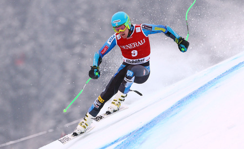 Ted Ligety, of the United States, speeds down the course on his way to take sixth place in an alpine ski, men's World Cup Super-G, in Kitzbuehel, Austria, Friday, Jan. 25, 2013. (AP Photo/Alessandro Trovati)
