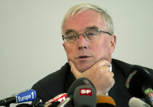 FILE - This is a Monday, Oct. 22, 2012 file photo of Pat McQuaid, President of the Union Cycliste Internationale, UCI, as he informs about the position of the UCI regarding the decision from USADA in the case of Lance Armstrong, during a press conference in Geneva, Switzerland.  The head of cycling's governing body has been replaced on a key International Olympic Committee panel as he deals with the fallout from the Lance Armstrong doping scandal. International Cycling Union President Pat McQuaid said Wednesday he was too busy to attend all the meetings of the Olympic commission evaluating bids for the 2020 Summer lympics.(AP Photo/Keystone, Salvatore Di Nolfi, File)
