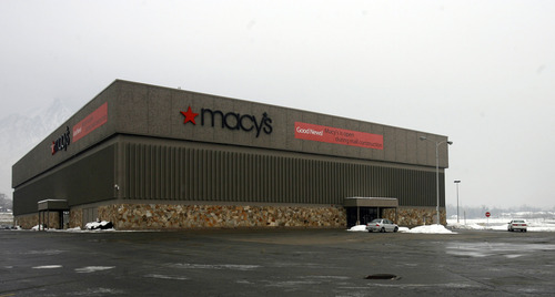"Rick Egan  |  The Salt Lake Tribune  Macy's department store sits all alone where the Cottonwood Mall used to be and still sports a banner that says, ""Macy's is open during mall construction."""