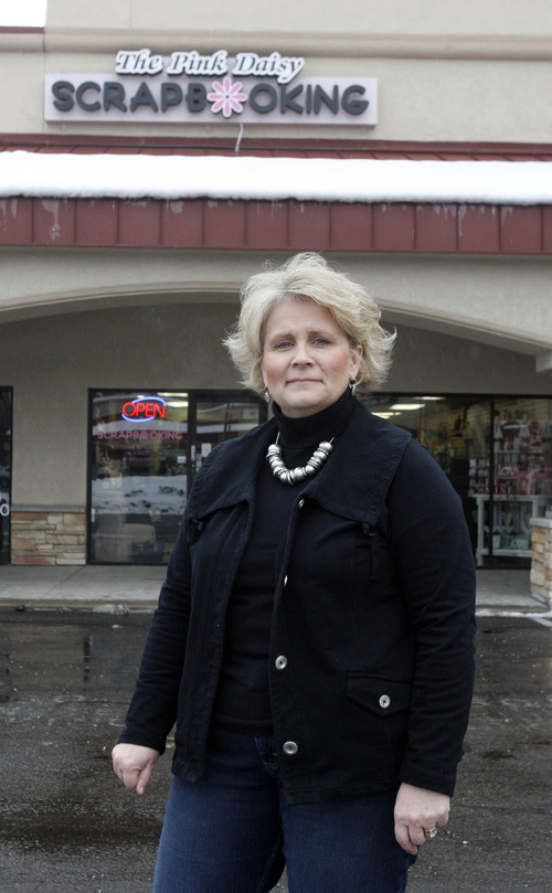 Rick Egan  |  The Salt Lake Tribune  Suzie Matheson stands in front of The Pink Daisy scrapbooking store she owns on Murray-Holladay Road in the Holladay Center north of Macy's, Thursday, Jan. 24, 2013. She tries to remain hopeful but says she does half the business she used to do before the Cottonwood Mall was demolished.