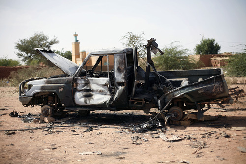 In this image taken during an official visit organized by the Malian army to the town of Konna, some 680 kilometers (430 miles) north of Mali's capital Bamako Saturday, Jan. 26, 2013, a Malian army vehicle used by islamist rebels stands charred.  One wing of Mali's Ansar Dine rebel group has split off to create its own movement, saying that they want to negotiate a solution to the crisis in Mali, in a declaration that indicates at least some of the members of the al-Qaida linked group are searching for a way out of the extremist movement in the wake of French air strikes. (AP Photo/Jerome Delay)